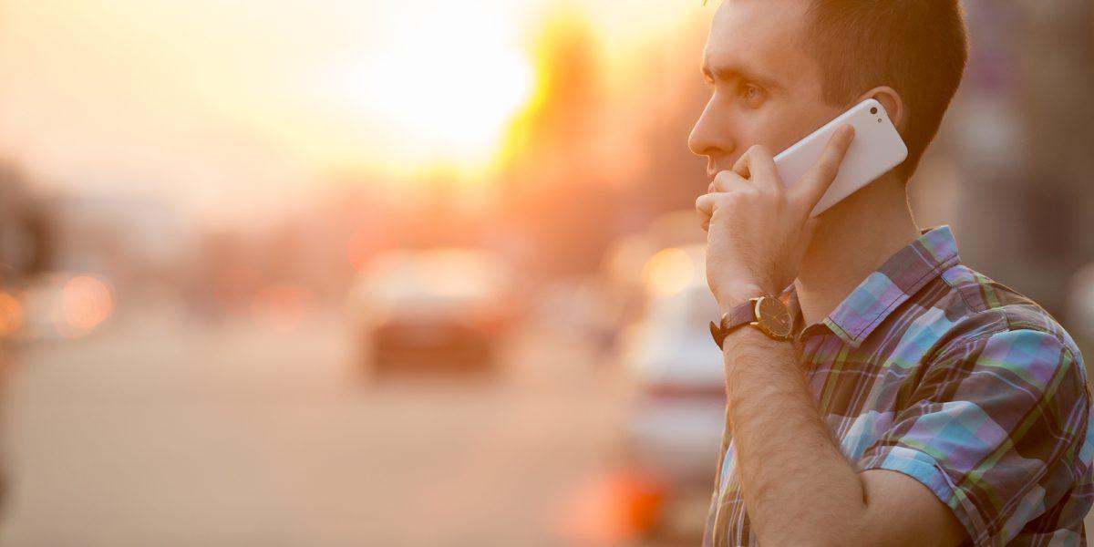 A person using critical alert systems via their phone
